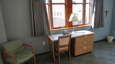 view of desk and window in bedroom