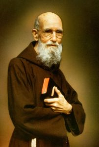 Solanus Casey in monk's robes holding a bible