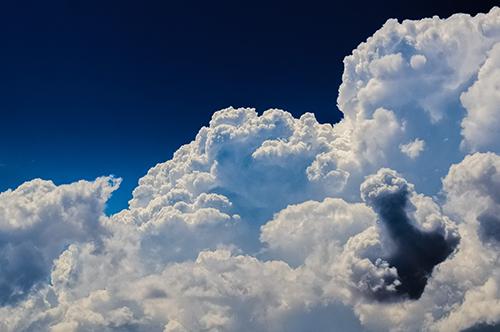 billowy clouds in a blue sky